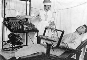 Use of Bergonic chair for giving electro convulsive treatment for psychological effect, in psycho-neurotic cases. World War 1 era.